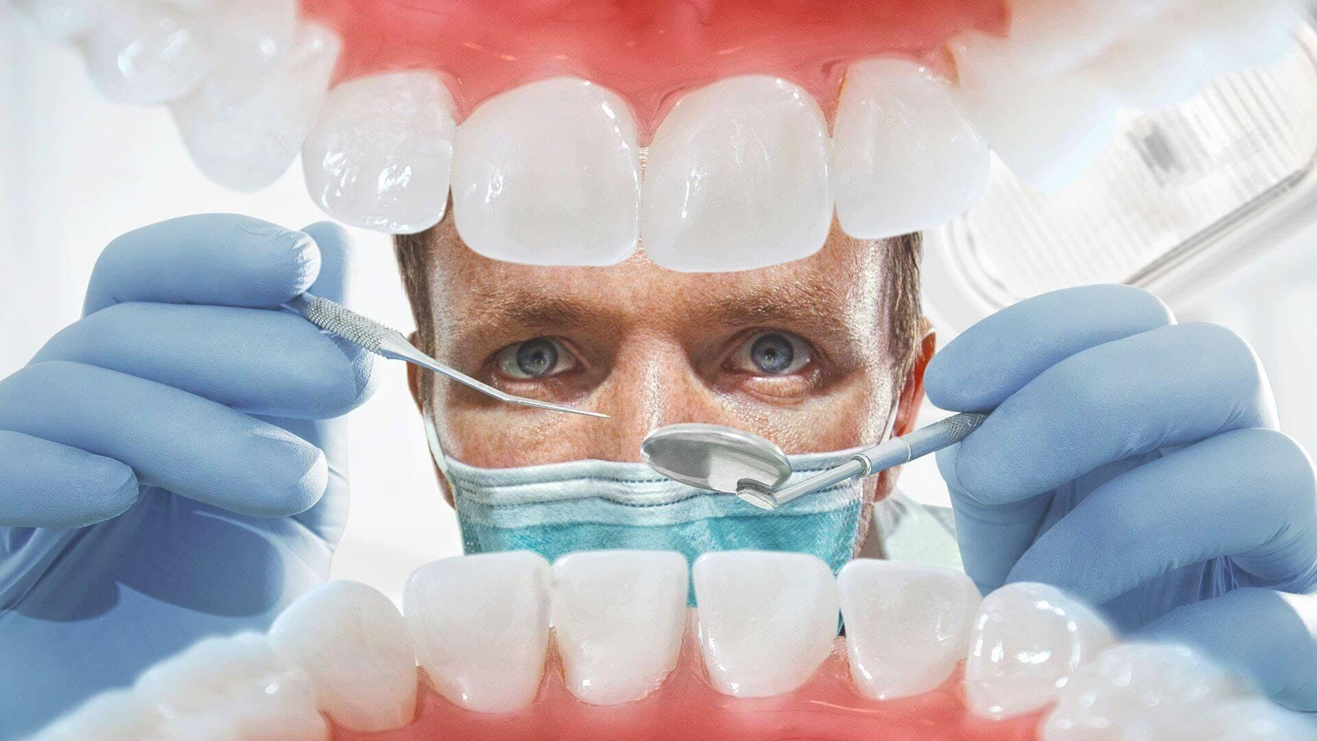 Dentist inspecting patient's mouth
