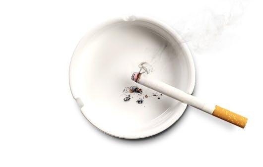 Lit cigarette in ashtray