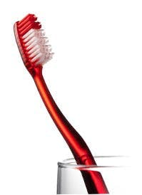 Red Toothbrush In Cup