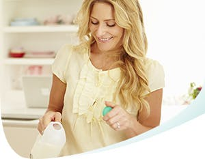 Woman pouring milk for herself