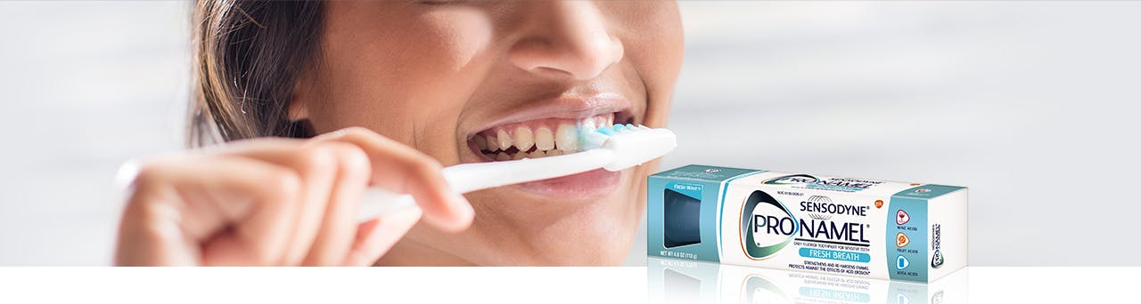 Brushing Teeth with Pronamel Toothpaste Header