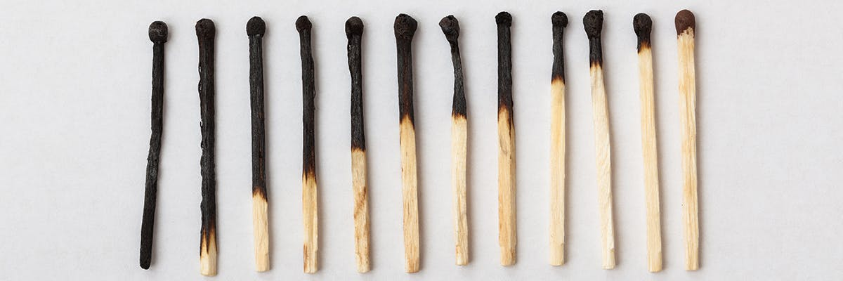 12 matches lying in a row with an ongoing reduced levels of burnt parts
