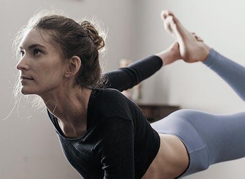 Woman practising yoga in a quiet room