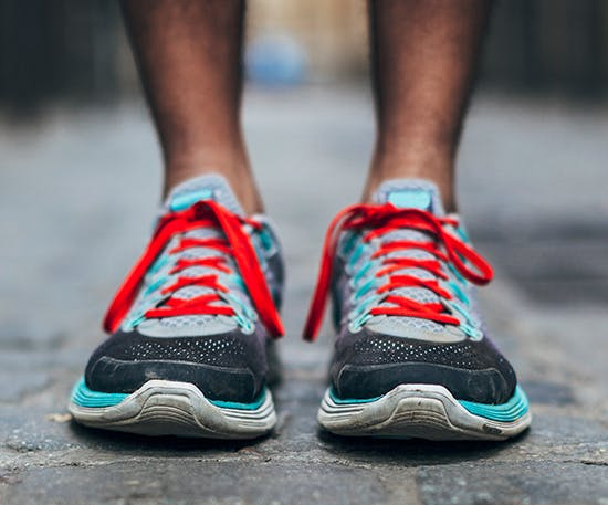 Man's feet in colourful running shoes