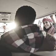 People smiling in a large van