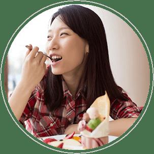Asian woman eating
