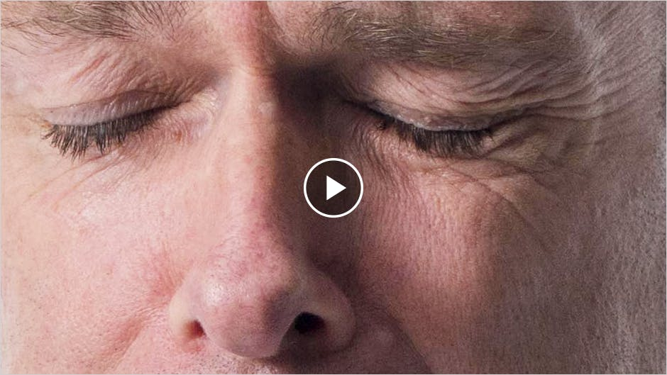 Closeup of man with eyes shut in pain