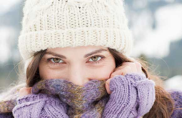 Woman bundled up in a hat and scarf