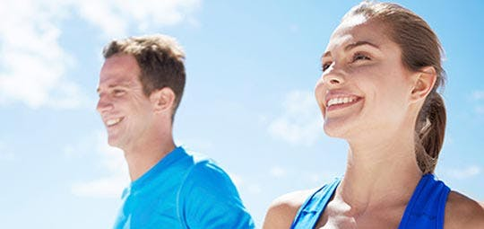Young man and young woman jogging outside
