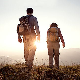 A couple of backpackers walking on a trail