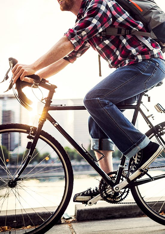 Side profile of a man riding a bicycle