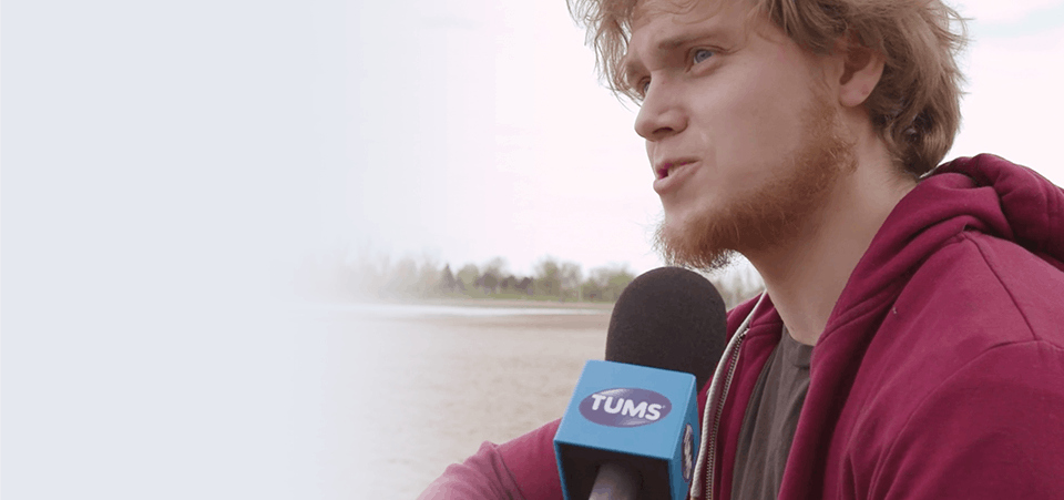 Young man being interviewed on a beach